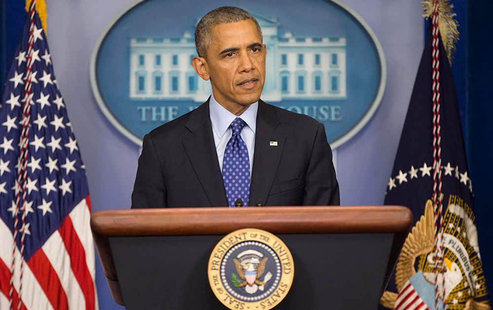 President Barack Obama speaks to members of the media about the situation in Iraq.