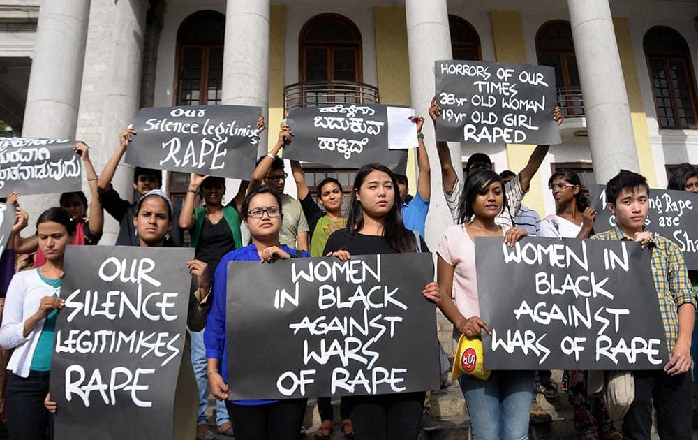 Activists of Women in Black protest against rape on women, in Bengaluru.