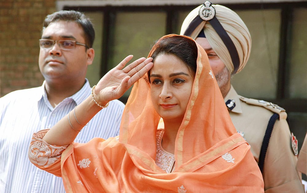 Union Minister Harsimrat Kaur Badal reviews a guard of honour at Circuit House on her maiden visit to her constituency Bathinda.