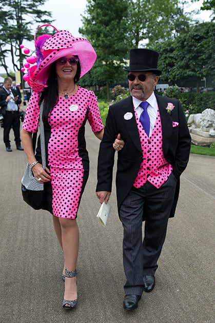 Brian Mann and Rachel Johnson wear matching black spots on pink on the third day of the Royal Ascot horse racing meeting, which is traditionally known as Ladies Day, at Ascot, England.