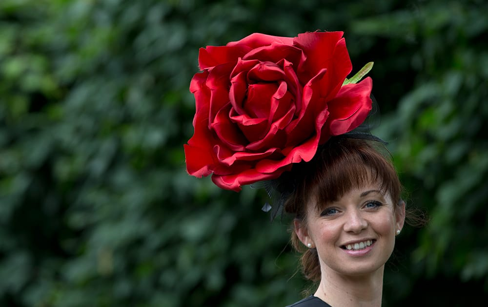 Joanne Casey wears a rose motif hat on the third day of the Royal Ascot horse racing meeting, which is traditionally known as Ladies Day, at Ascot, England.