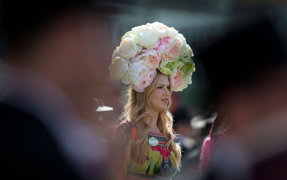 Natalie Kapchuck wears a floral hat on the second day of the Royal Ascot horse racing meeting at Ascot, England.