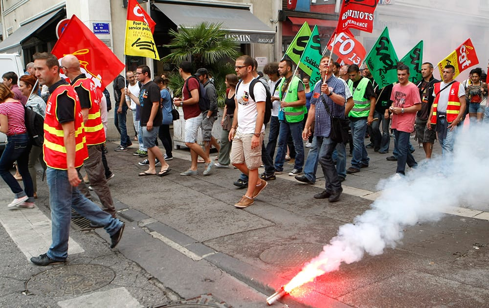 Workers of the French national railway SNCF demonstrate in the downtown of Marseille, southern France.