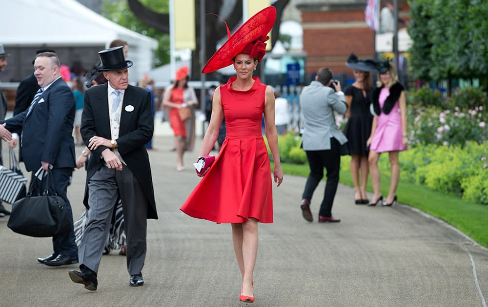 Milnda Strudwick wears a large red ornate hat on the second day of the Royal Ascot horse racing meeting at Ascot, England.