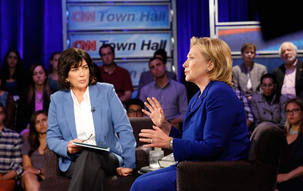 Hillary Rodham Clinton speaks during CNN`s Town Hall interview. The former secretary of state expressed caution Tuesday about the United States working with Iran to combat fast-moving Islamic insurgents in Iraq, saying the U.S. needs to understand `what we`re getting ourselves into.`