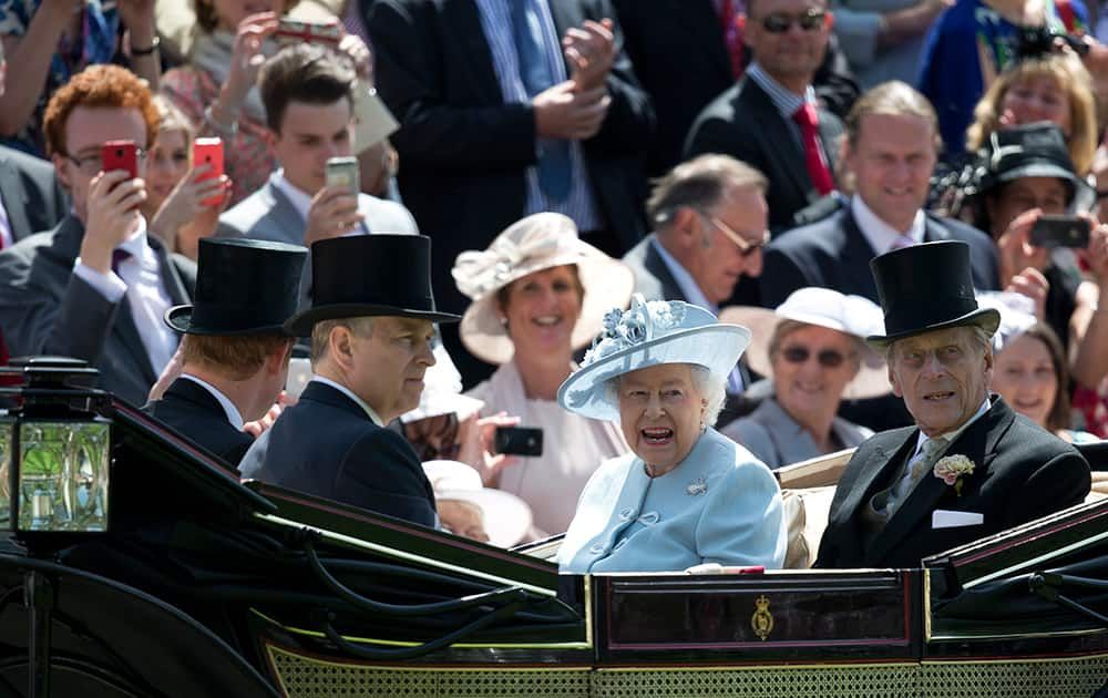 Britain`s Queen Elizabeth II with Prince Philip, Prince Andrew and Prince Harry, arrive by carriage, on the first day of the Royal Ascot horse racing meeting at Ascot, England.