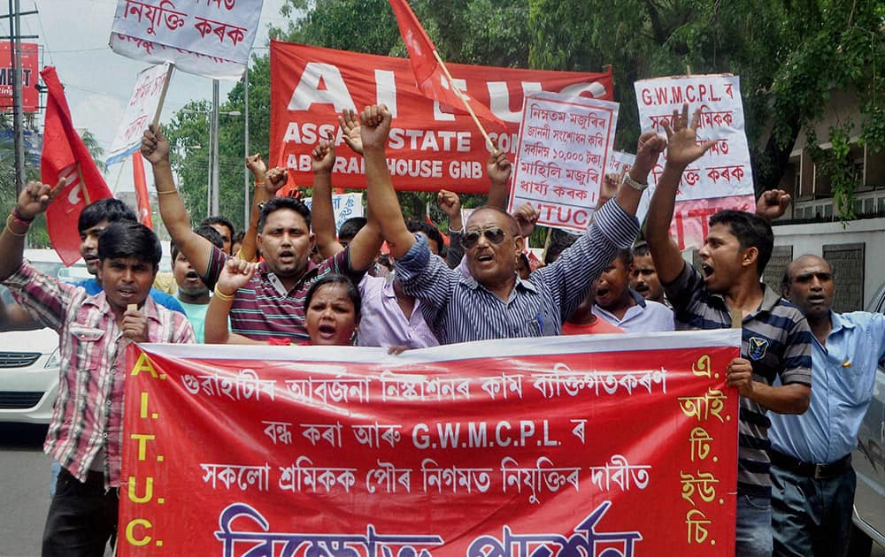 AITUC members taking out a protest rally in Guwahati on Tuesday in support of their demands.