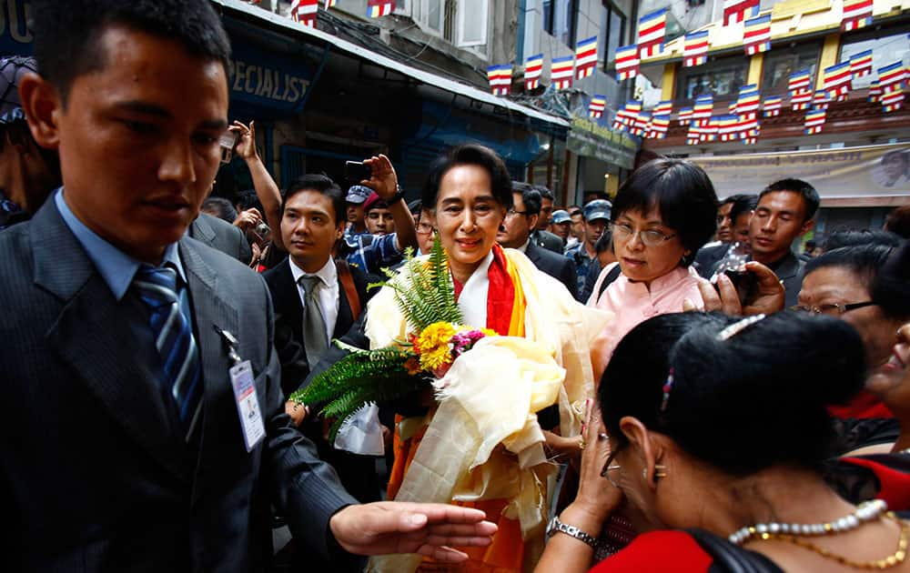 Nepalese people welcome Myanmar opposition leader Aung San Suu Kyi upon arrival at Sigal Monastery in Katmandu, Nepal. Suu Kyi arrived in Nepal Friday to attend a democracy conference, meet top political leaders and visit Buddhist pilgrimage sites.