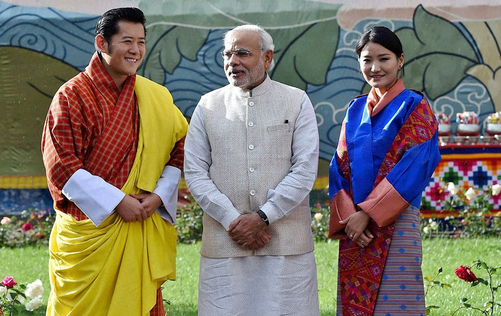 Visiting Indian Prime Minister Narendra Modi, stands with Bhutan`s King Jigme Khesar Namgyel Wangchuck, left and Queen Jetsun Pema, right, during a ceremonial reception at Royal Palace in Thimphu, Bhutan.