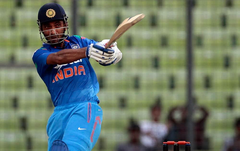 India`s Ajinkya Rahane plays a shot during their first one-day International cricket match against Bangladesh in Dhaka, Bangladesh.
