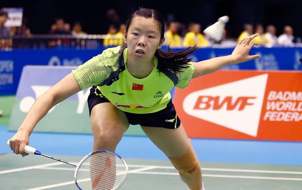 China`s Li Xuerui returns a shot against Tai Tzu-ying of Taiwan during their final match of the Japan Open badminton championship.