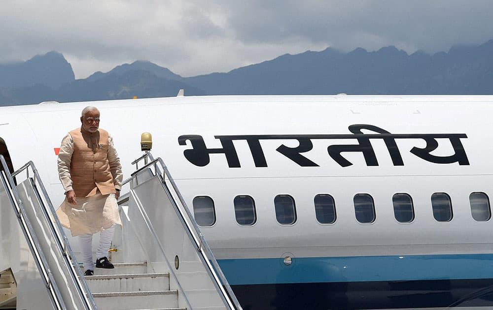 Prime Minister Narendra Modi arrives at the Paro International Airport in Bhutan.