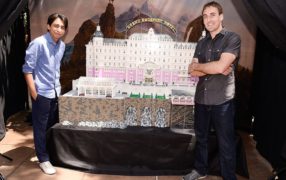 Actor Tony Revolori and builder Ryan Ziegelbauer unveil a remarkable model inspired by Wes Anderson`s `The Grand Budapest Hotel` and constructed entirely of Lego bricks at The Grove in Los Angeles.