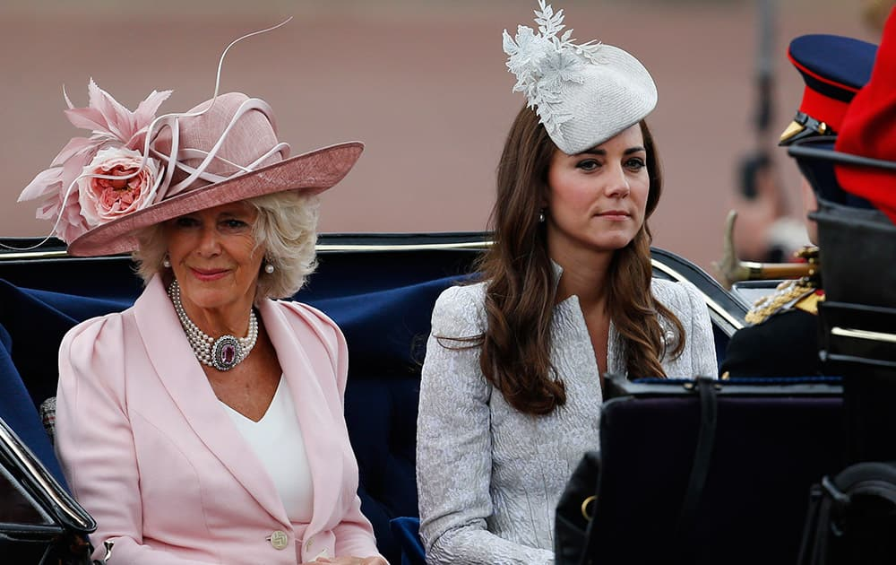 Britain`s Camilla, Duchess of Cornwall, left, and Kate, Duchess of Cambridge, right, leave in a horse drawn carriage to attend the Trooping the Colour parade, in central London.