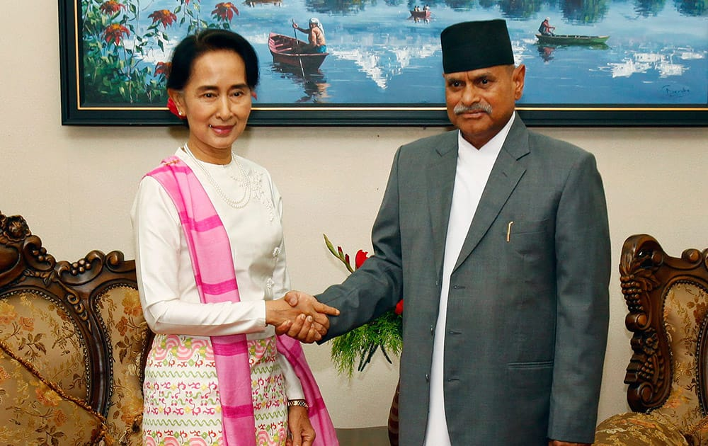 Myanmar opposition leader Aung San Suu Kyi, left, and Nepal's President Ram Baran Yadav pose for photos during a meeting at the president`s residence in Katmandu, Nepal.