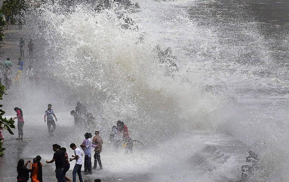Visitors enjoy high tide at Marine Drive in Mumbai.