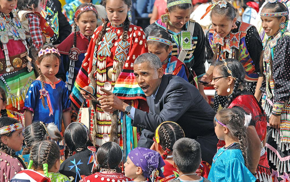 President Barack Obama visits with Native American youngsters during his visit to Cannon Ball, N.D.