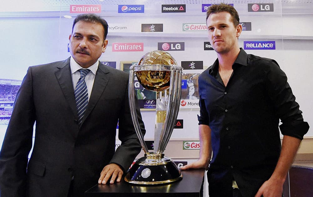 Former Indian captain Ravi Shastri with former Australian cricketer Shaun Tait at the unveiling of the ICC Cricket World Cup trophy in Mumbai.