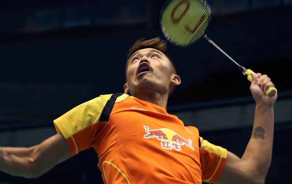 Lin Dan of China plays against Chong Wei Feng of Malaysia during the second round of the Japan Open Badminton Championship.