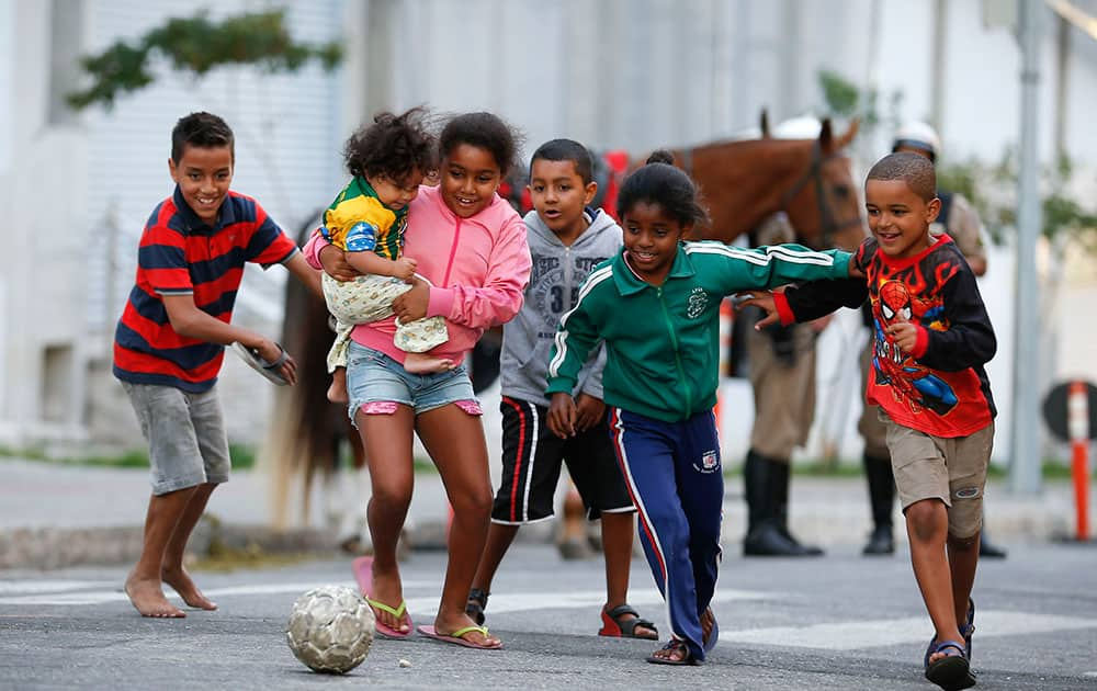 Children kick around a soccer ball outside the Independencia Stadium in Belo Horizonte, Brazil.