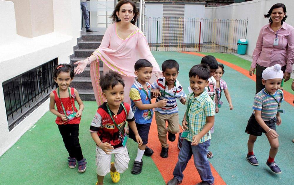 Nita Ambani, Founder & Chairperson, Reliance Foundation with kids at the opening of a Foundation`s school at Koparkhairane, Navi Mumbai.