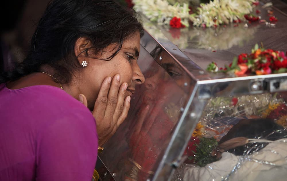 The mother of Gampala Aishwarya, one of the students who was swept away in a sudden dam release, weeps at their residence during her funeral in Hyderabad.
