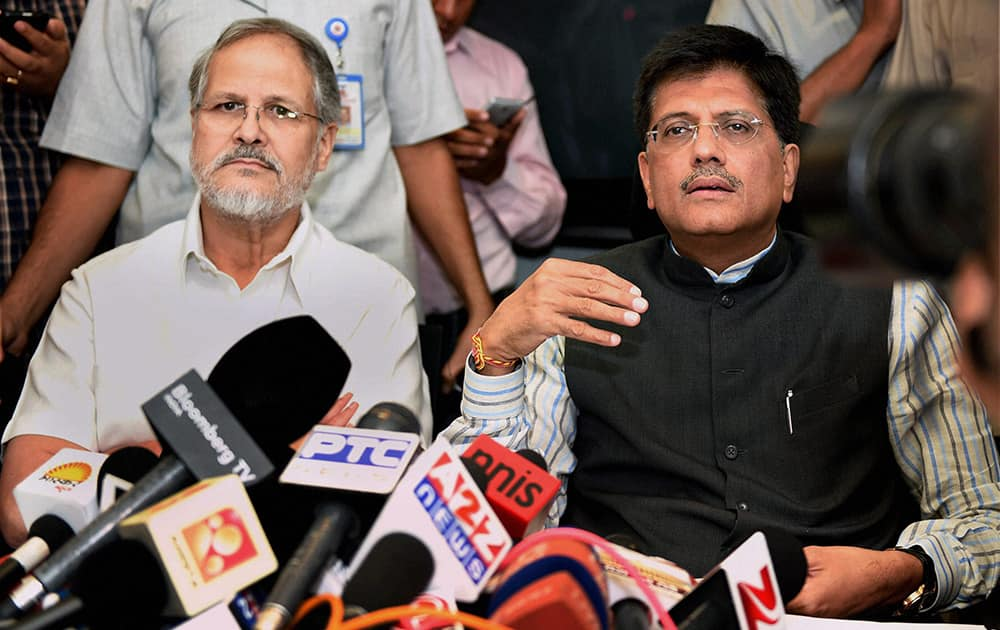 Union Minister of State for Power, Piyush Goyal withi Lt. Governor og Delhi Najeeb Jung talking to media after an emergency meeting to discuss plan of action to tackle power crises, in New Delhi.