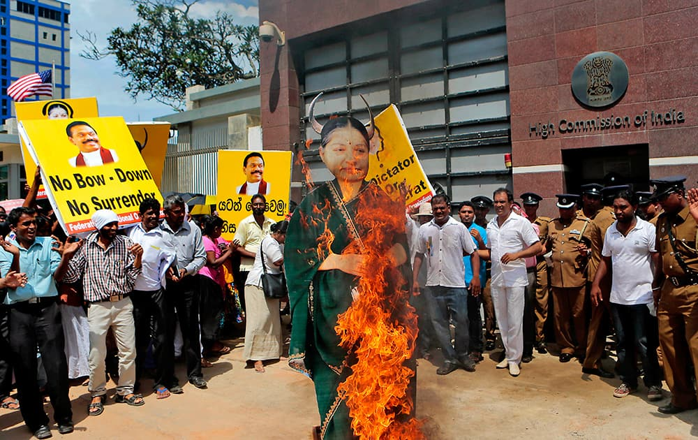 Sri Lankan pro-government supporters representing Federation of National Organizations burn an effigy of Tamil Nadu state Chief Minister Jayaram Jayalalitha during a demonstration outside the Indian High Commission in Colombo, Sri Lanka.