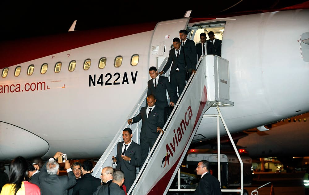 Players from Costa Rica`s soccer team exit a plane as they arrive at the Sao Paulo International airport, Brazil.