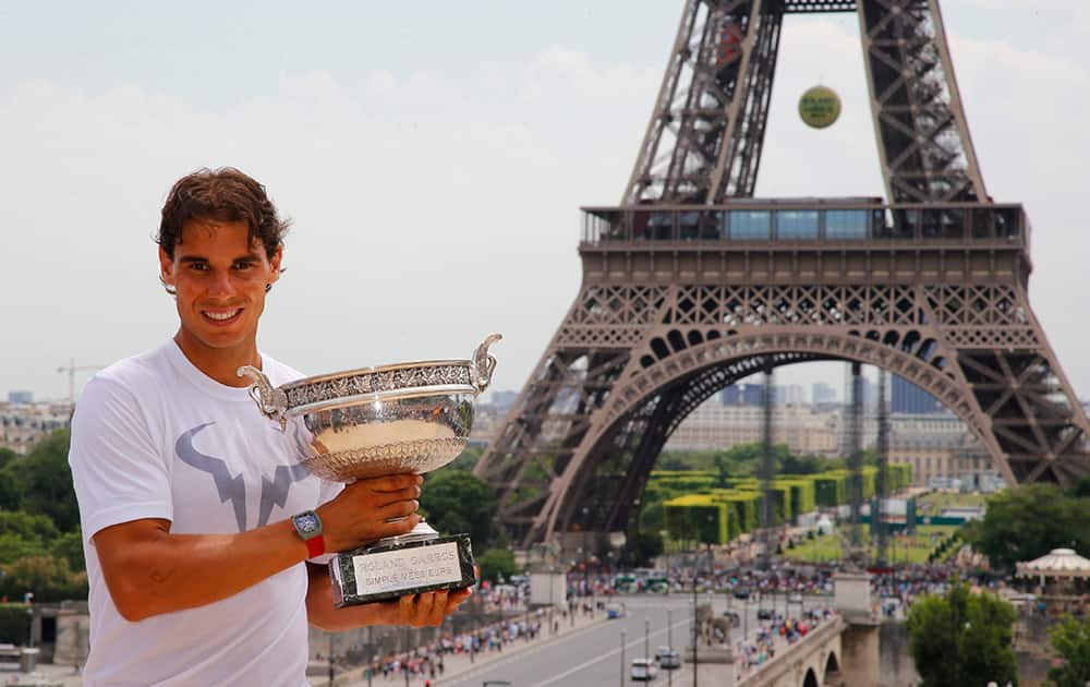 Spain`s Rafael Nadal poses with his French Open Tennis trophy during a photo session at Trocadero, next to the Eiffel Tower, in Paris. The 28-year-old Spaniard beat Novak Djokovic 3-6, 7-5, 6-2, 6-4 at Roland Garros to capture his fifth straight and career ninth French Open title.