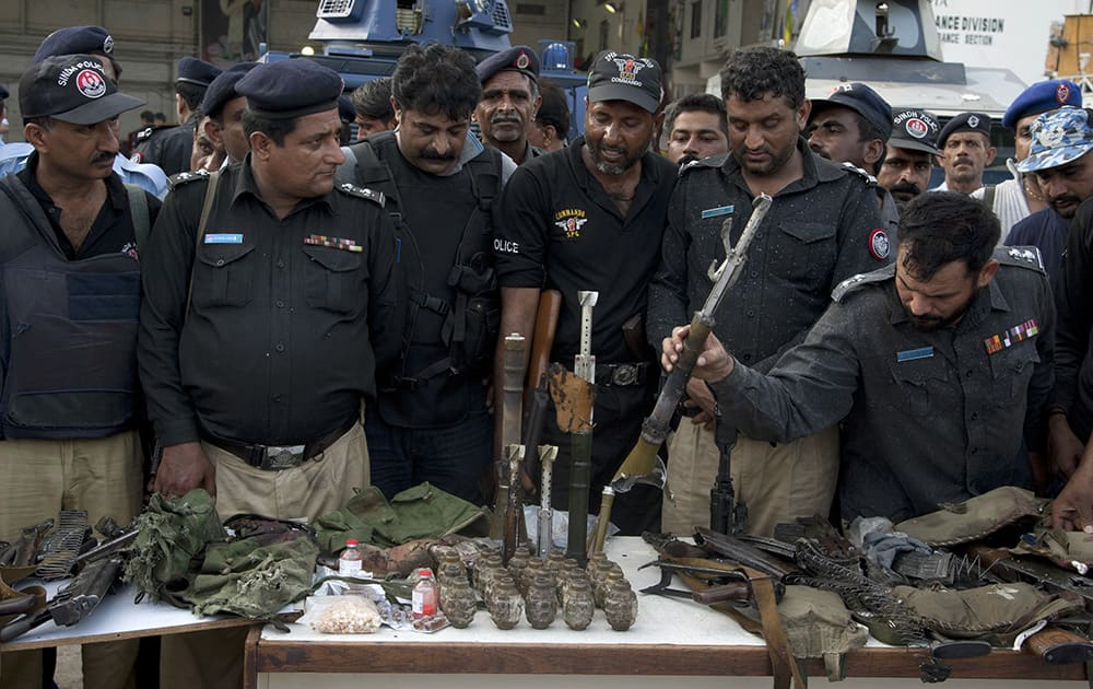Pakistani police officers display ammunition confiscated from attackers at the Jinnah International Airport in Karachi, Pakistan.