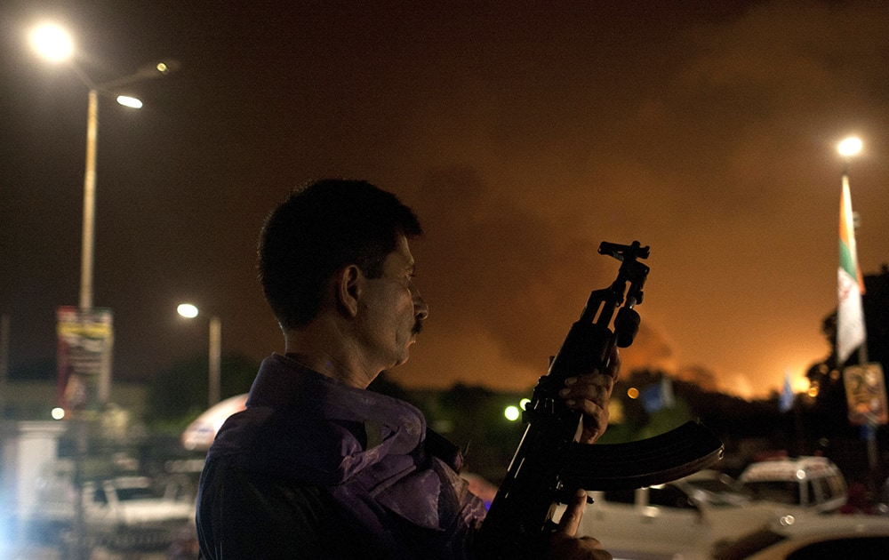 A Pakistani soldier takes position at Jinnah International Airport where security forces are fighting with gunmen who disguised themselves as police guards and stormed a terminal used for VIPs and cargo, Sunday night, June 8, 2014, in Pakistan.