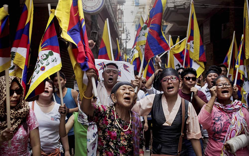 Exiled Tibetans shout slogans during a protest against the visit of Chinese Foreign Minister Wang Yi in New Delhi.