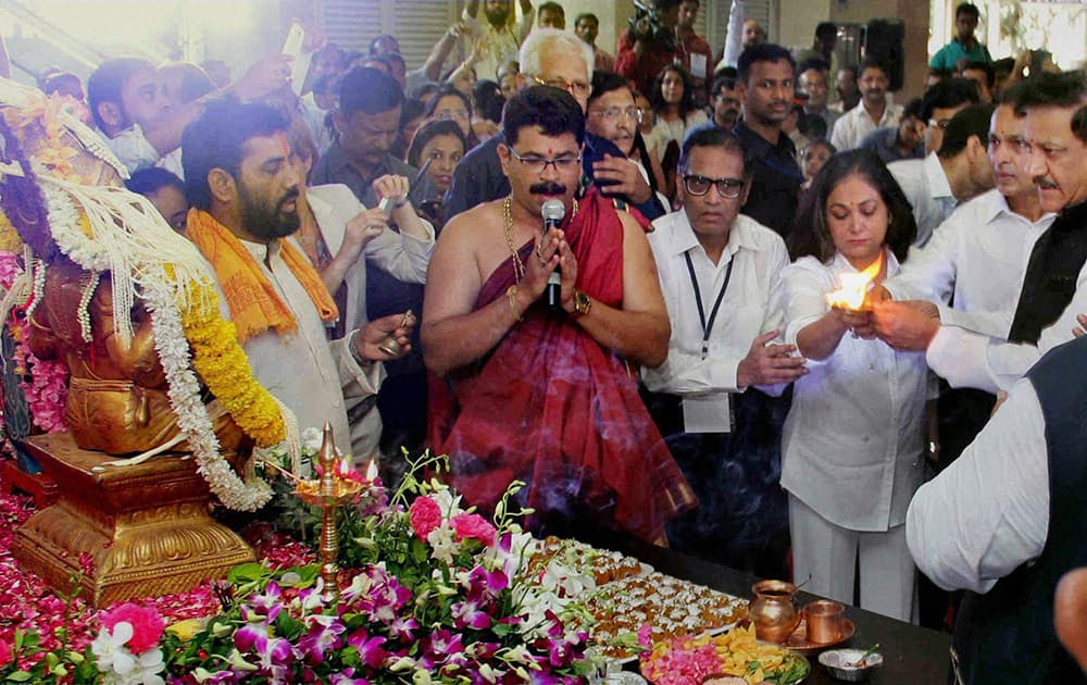 Maharashtra Chief Minister Prithviraj Chavan, Anil Ambani and Teena Ambani perform prayers at the inauguration of Mumbai`s first metro rail from Versova station.