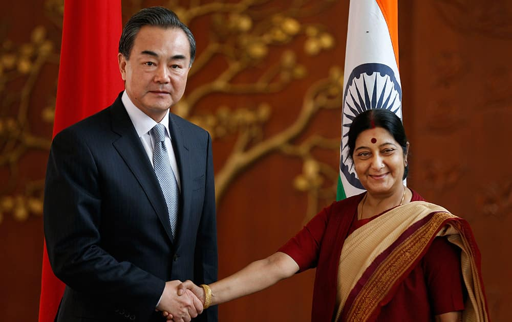 Indian External Affairs Minister Sushma Swaraj, shakes hands with her Chinese counterpart, Wang Yi, before their meeting in New Delhi.
