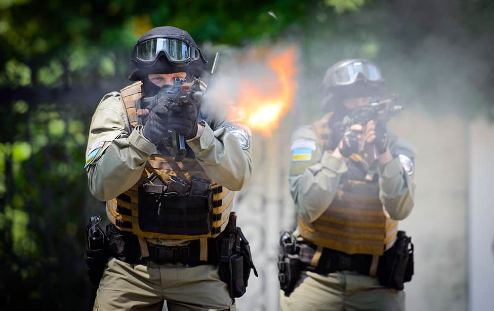 Ukrainian special forces fire during their training outside in Kharkiv, Ukraine. In recent weeks, Ukrainian officials say more than 200 people have died - a figure that could not be independently confirmed - in fighting between Ukrainian government troops and pro-Russian separatists in eastern Ukraine.
