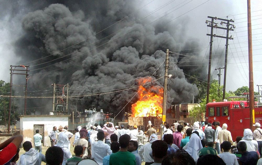 Flames and smoke coming out of Shakhowa power house plant after a fire, in Mirzapur.