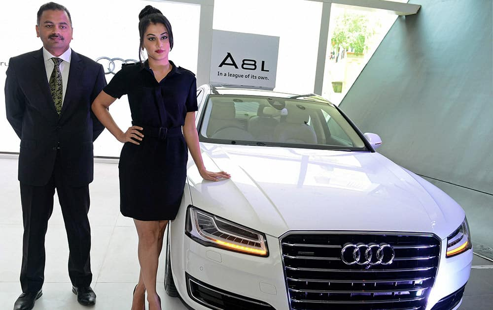 Audi Chennai CEO K Subramanian and actress Taapsee launching the new A 8L in Chennai.