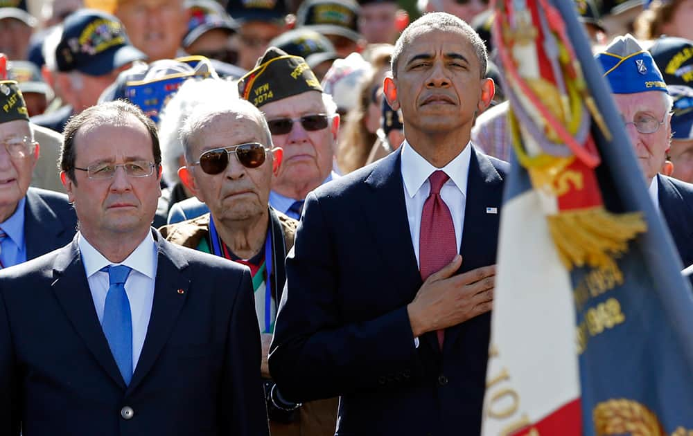 US President Barack Obama and French President Francois Hollande, participate in the 70th French-American commemoration D-Day ceremony at the Normandy American Cemetery and Memorial in Colleville-sur-Mer, France.