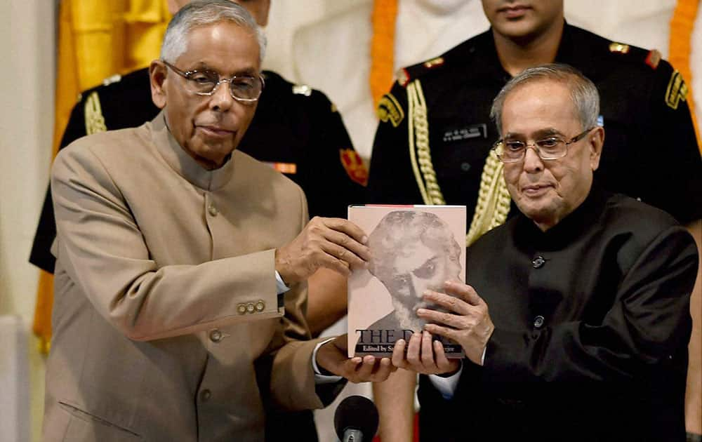 President Pranab Mukherjee receives the first copy of the second edition of The Dawn, Volume-I, from WB Governor M K Narayanan during inauguration of a programme to celebrate 150th Birthday of Acharya Satis Chandra Mukherjee in Kolkata.