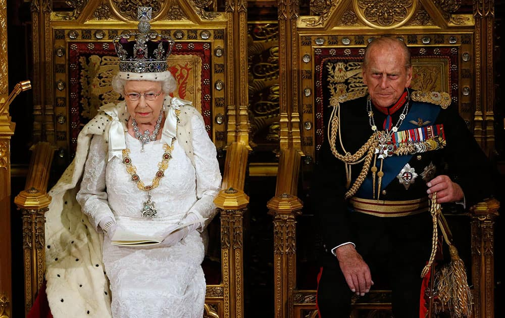 Britain`s Queen Elizabeth II, left, sits with Prince Philip, the Duke of Edinburgh, as she delivers her speech in the House of Lords, during the State Opening of Parliament, at the Palace of Westminster, in London.
