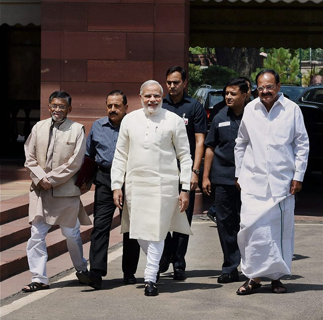Prime Minister Narendra Modi being welcomed by Union Minister for Parliamentary Affairs M Venkaiah Naidu and MoS Santosh Kumar Gangwar at Parliament House on the first day of 16th Lok Sabha, in New Delhi.