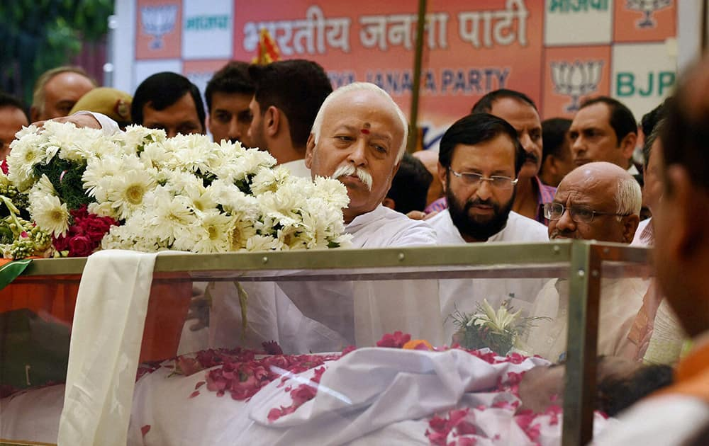 RSS chief Mohan Bhagwat while paying his last respect to the mortal remains of Union minister Gopinath Munde at the BJP headquarters in New Delhi on Tuesday. Munde died on Tuesday morning in a road accident in New Delhi.