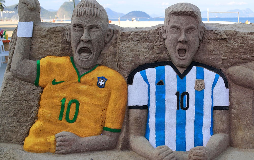 A sand sculpture featuring soccer players, Neymar of Brazil, left, and Lionel Messi of Argentina, on Copacabana beach in Rio de Janeiro, Brazil.