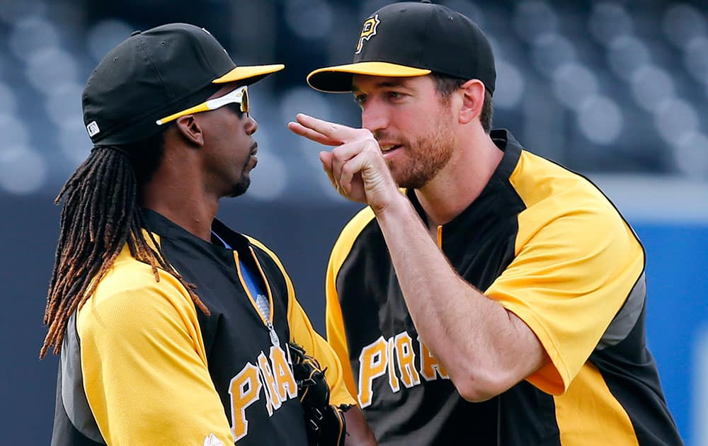 Pittsburgh Pirates` Ike Davis, right, lets Andrew McCutchen knows he is jokingly watching him before a baseball game against the San Diego Padres.