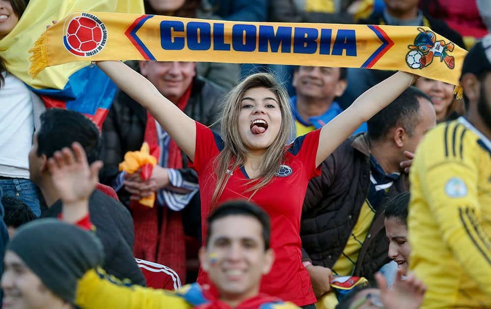 A Colombian fan cheers for her team before an international friendly soccer match against Senegal in Buenos Aires, Argentina.
