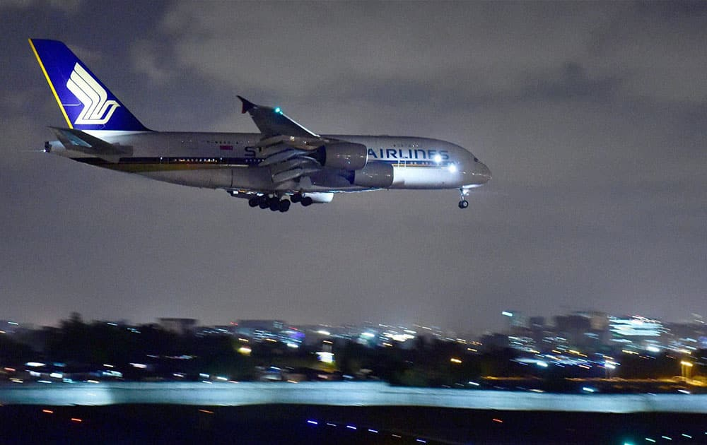 Singapore Airlines` Airbus A380 aircraft prepares to land at the International Airport in Mumbai.