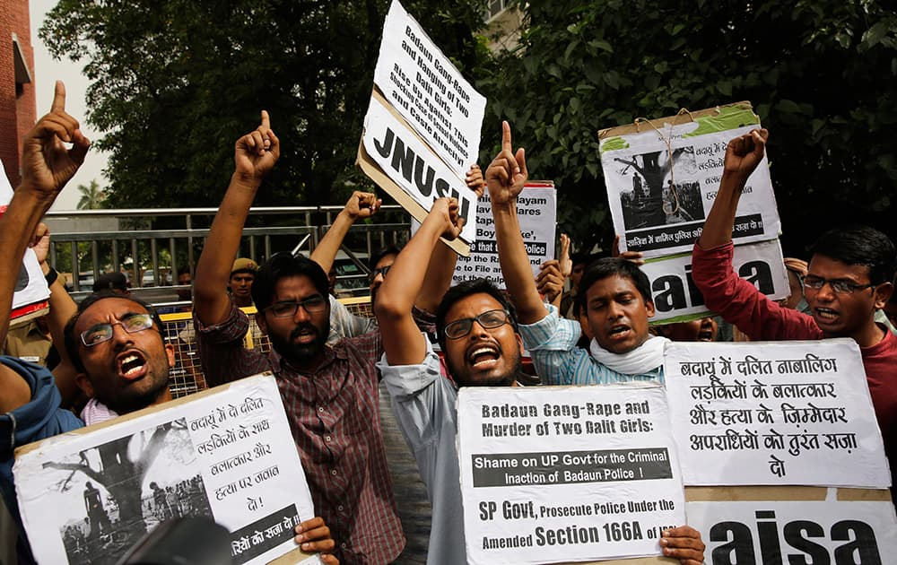 Members of Jawaharlal Nehru University Students Union shout slogans during a protest against a gang rape of two teenage girls in Katra village, outside the Uttar Pradesh state house, in New Delhi.