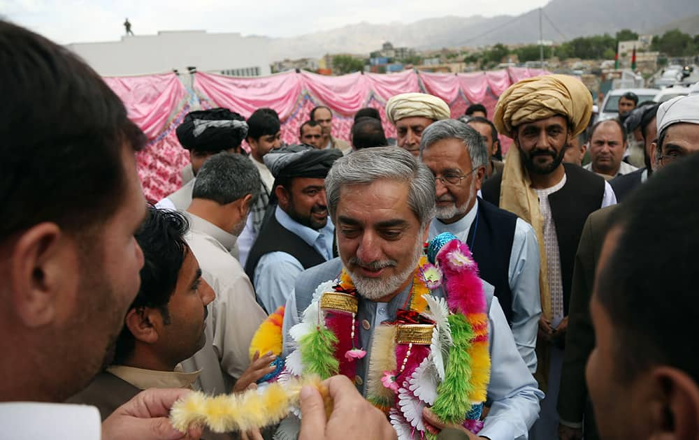 Afghan presidential candidate Abdullah Abdullah, center, greets his supporters during a campaign rally in Kabul, Afghanistan. The second round of Afghanistan`s presidential election will take place on June 14, 2014.