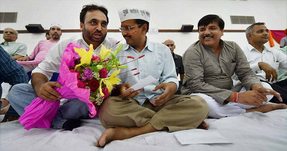 AAP convener Arvind Kejriwal greets party`s newly elected MP Bhagwant Mann during the party workers meeting in New Delhi.
